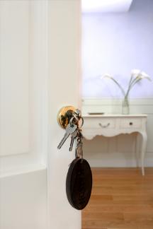 Hausschlüssel in Türschloss